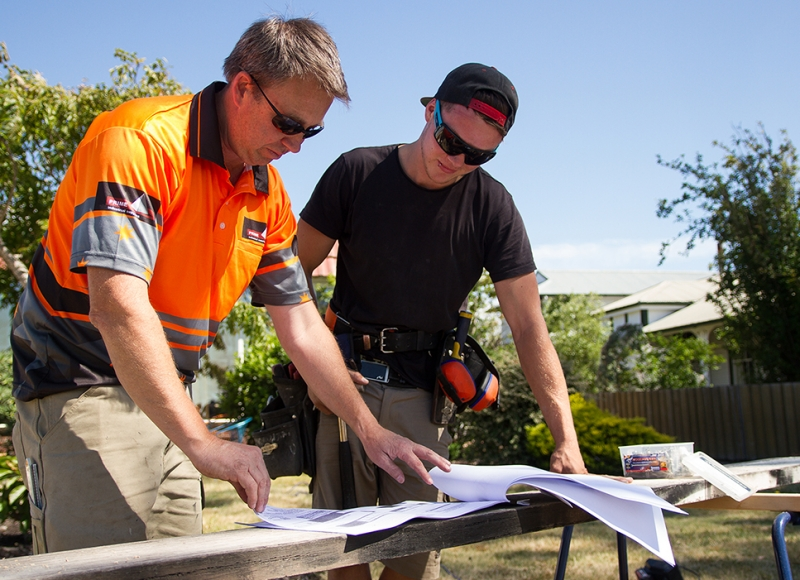 Apprentice and boss reviewing plans at Tasmanian Building Group Apprenticeship scheme