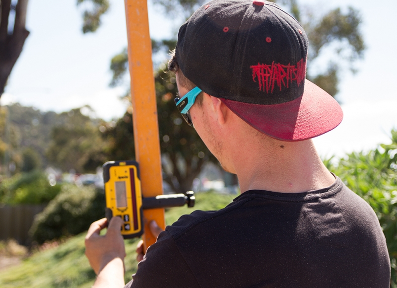 Apprentice using level at Tasmanian Building Group Apprenticeship scheme