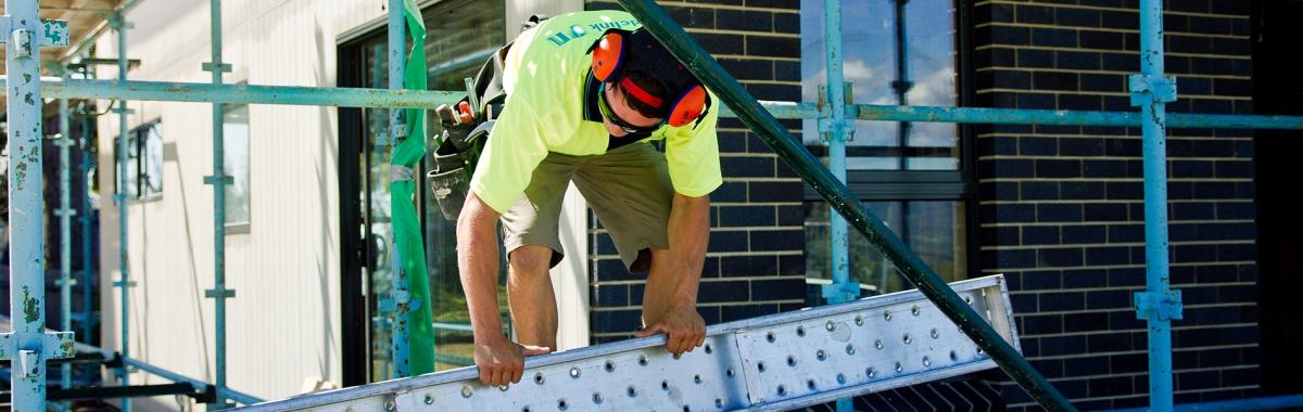 Apprentice moving ladder at Tasmanian Building Group Apprenticeships