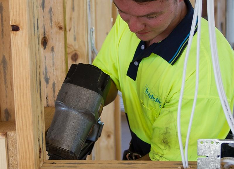 Apprentice using nail gun at Tasmanian Building Group Apprenticeship scheme