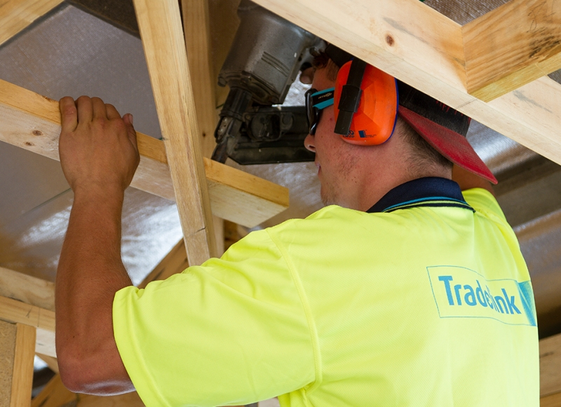 Apprentice working on ceiling joists at Tasmanian Building Group Apprenticeship scheme