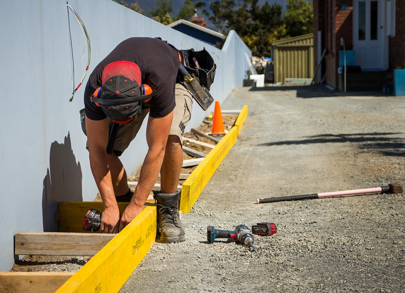 Apprentice working on house fence at Tasmanian Building Group Apprenticeship scheme