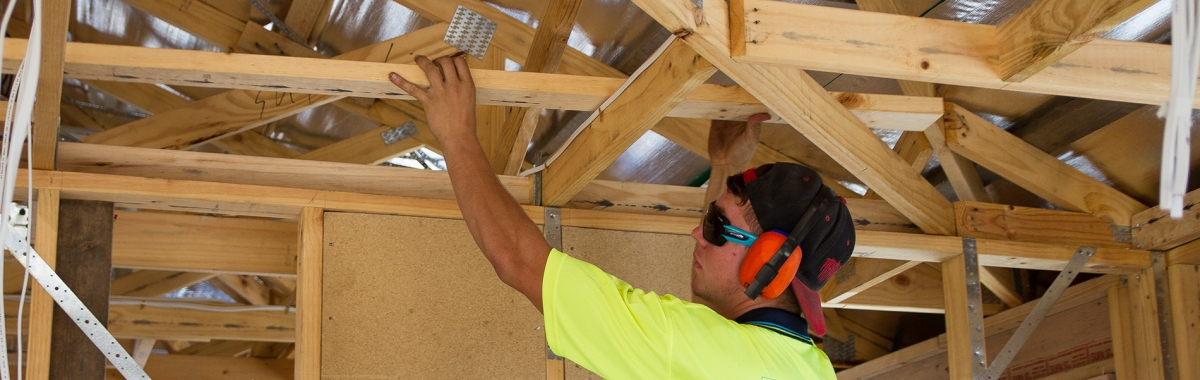 Apprentice at Tasmanian Building Group Apprenticeships working on a house